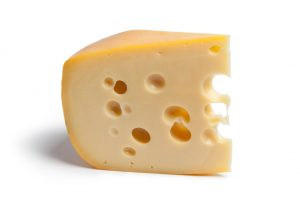 Piece of Dutch farmers cheese with holes